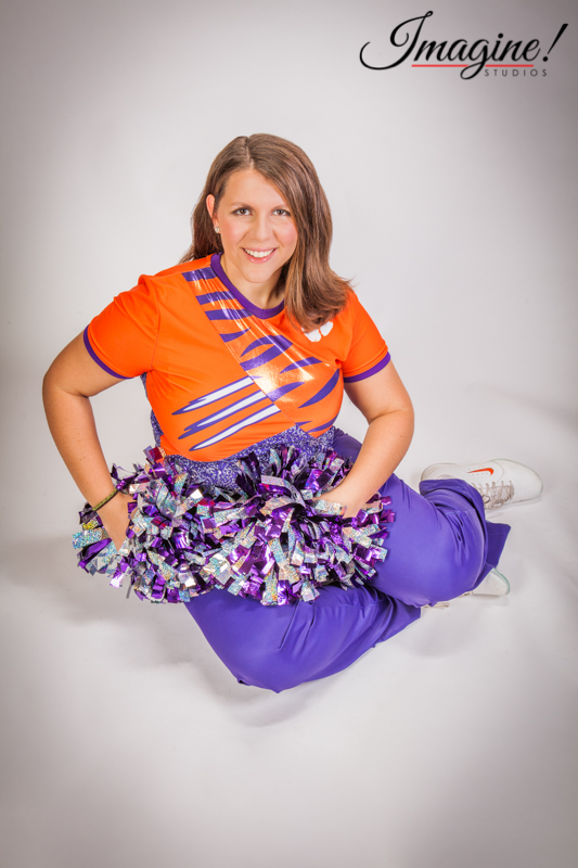 Amethyst in her Tiger Guard uniform sits with her pom poms