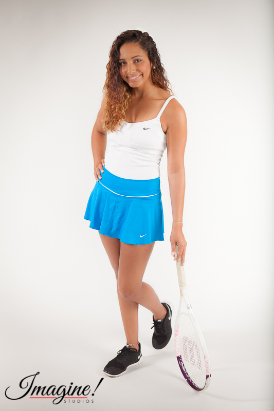 Brianna poses on her tennis racquet in the studio