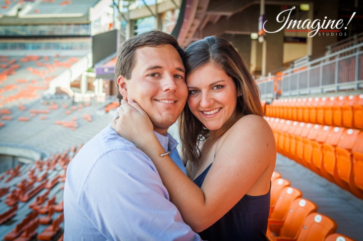 Hannah and Brad embrace in the WestZone at Clemson Memorial Stadium